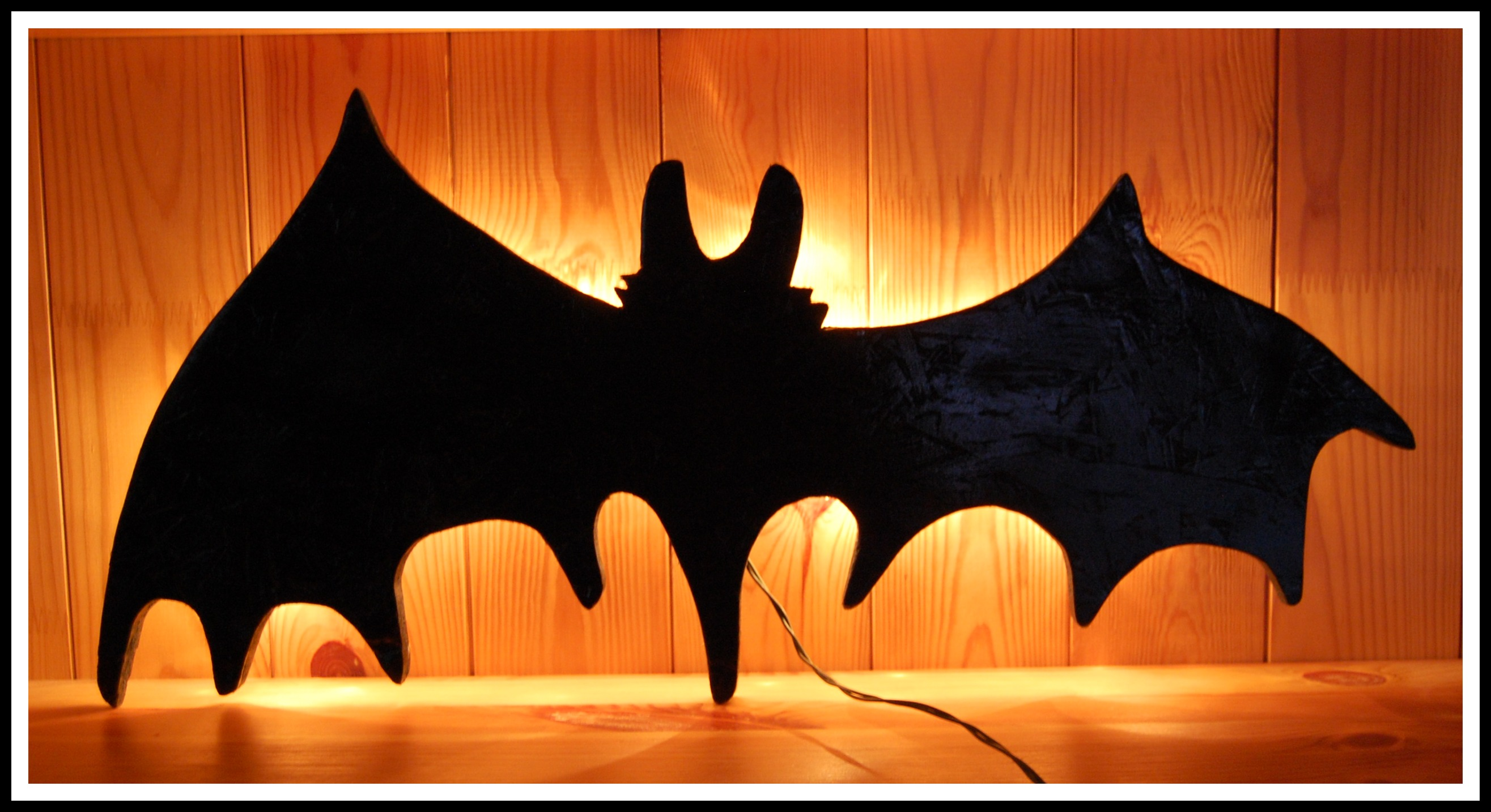 remember the neat bat that mommy made from wood but she got creative this morning and really changed up the bat into an awesome halloween decoration - Bat Halloween Decorations