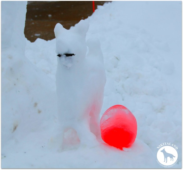 SNOW BELLA WITH RED ICE BALL
